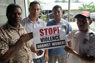 live_and_learn_staff_pose_with_a_stop_violence_against_women_sign-_10708149455